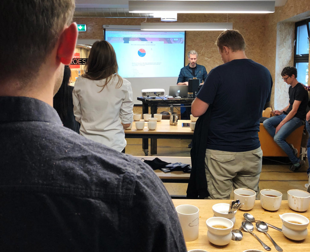 Geoff delivering presentation in Tim Wendelboe's workshop