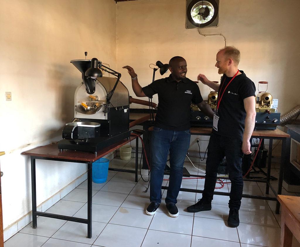 Alex in Rwanda at sample roasting lab